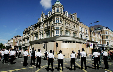 Police officers stand together along the route of the annual Notting Hill Carnival in London.