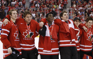 Canada players celebrate after defeating Sweden at the gold medal game at the 2009 IIHF U20 World Junior Hockey Championships in Ottawa