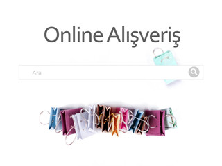 Online alisveris (online shopping) in Turkish language. E-commerce online shopping concept. Miniature of reusable grocery bags.