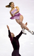 CANADIANS LARIVIERE AND FAUSTINO PERFORM SHORT PROGRAM AT WINTER GAMES.
