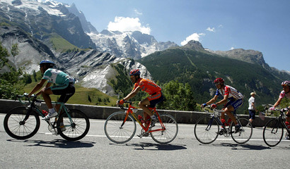 The pack of riders tackle the French Alps during the 184.5km ninth stage of the Tour de France cycli..