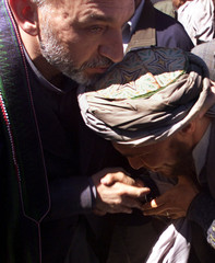 AFGHAN INTERIM LEADER KARZAI GREETED BY EARTHQUAKE SURVIVOR.