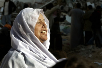 A Palestinian woman cries in front of the her house after it was demolishied by Israeli bulldozers i..
