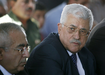 Palestinian President Abbas and Fayyad attend Friday prayers in the West Bank city of Ramallah