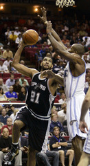 Spurs forward Duncan is fouled by Magic center Howard during first half NBA basketball action in Orlando