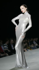 Model presents creation by Russian designers Olga and Anna Kameneva during Moscow Fashion Week in Moscow