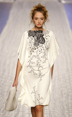 A model displays a creation by Ukrainian designer Dats during fashion week in Kiev
