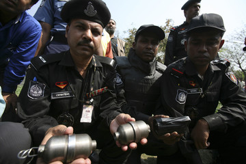 Members of the Bangladesh Rapid Action Battalion display grenades seized from the house of a member of an underground Islamist group in Gazipur