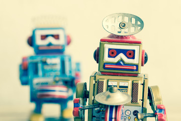 Close up old robot toy on wood table, vintage color style, vintage tone background.