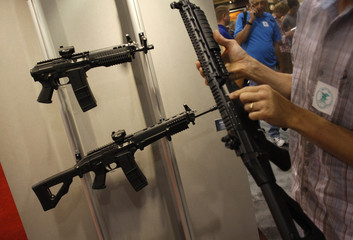 Assault rifles sit on a display during the National Rifle Association's (NRA) Annual Meeting & Exhibits in Phoenix