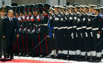 RUSSIAN PRESIDENT VLADIMIR PUTIN REVIEWS THE HONOUR GUARD DURING ANOFFICIAL WELCOMING CEREMONY IN ROME.