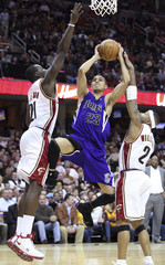 Sacramento Kings  Garcia drives to basket past Cleveland Cavaliers Hickson and Williams during fourth quarter of their NBA basketball game in Cleveland