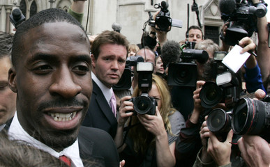 Sprinter Dwain Chambers leaves the High Court in London