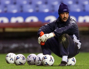 England and Arsenal goalkeeper David Seaman watches team mates training at Villa Park, Birmingham Fe..