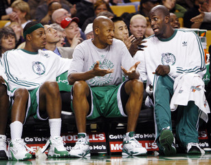Boston Celtics forward Paul Pierce, guard Ray Allen and forward Kevin Garnett talk on a bench during the fourth quarter of their NBA basketball game against the Toronto Raptors in Boston