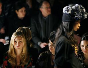 Actress Julia Stiles watches models during the Diane Von Furstenberg 2009 fall/winter show during New York Fashion Wee