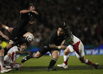 England's Care tackles New Zealand All Blacks' Nonu in their international rugby test match in Auckland