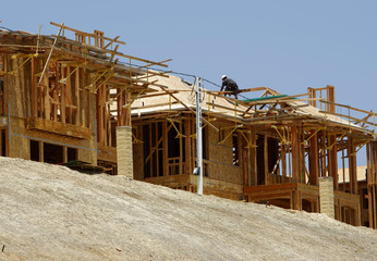 New home construction continues in Carlsbad, California as consumer sentiment slid to a 16-year low in June