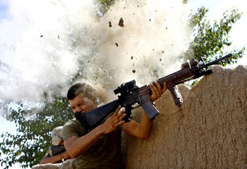 Sgt. William Olas Bee, a U.S. Marine from the 24th Marine Expeditionary Unit, has a close call after Taliban fighters opened fire near Garmsir in Helmand Province of Afghanistan