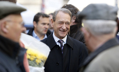 Paris city mayor Delanoe of the Socialist Party speaks with supporters at a political rally in Lormont near Bordeaux