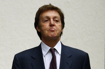 Britain's Paul McCartney arrives at the High Court in London