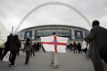 Fans walk along Wembley Way on the opening day of the new Wembley Stadium in London