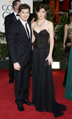 Actor Michael C. Hall and his guest arrive at the 66th annual Golden Globe awards in Beverly Hills, California
