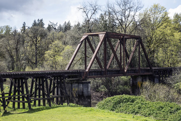 Iron Wood Railroad Trestle Train Tracks Bridge Canopy, Green Lush Trees Grass Vegitation, Blue Sky White Clouds, Picturesque , Americana, Daytime - Oregon USA (HDR Image)