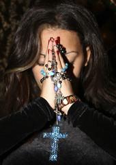 Woman prays during Christmas Mass at a Catholic church in Amman