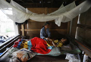 A mother looks after her HIV-infected child in a village of Payao province