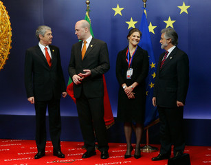 Portugal's PM Socrates and FM Amado welcome Sweden's PM Reinfeldt and Crown Princess Victoria at the start of a European Union Heads of State and Government at a EU summit in Brussels