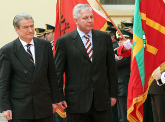 Albanian PM Berisha and his Croatian counterpart Sanader review an honor guard in Tirana