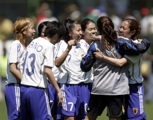 Japan's players celebrate qualifying for the World Cup after their FIFA Women's World Cup China 2007 second play-off soccer match against Mexico in Toluca City