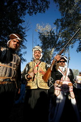 Horse riders in traditional robes pose during Algeria's 7th Horse festival in the country town of Tiaret