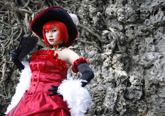 """A girl poses for a photo while dressed up as a character from the Japanese animation """"Black Butler"""" before a cosplay competition starts in Taipei County"""