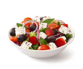 Greek salad in a bowl, on white background