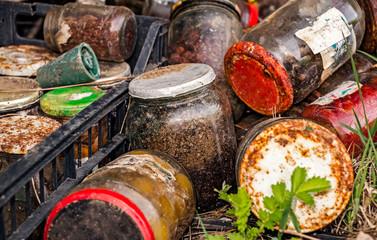 Jars of various cans polluting nature, closeup view