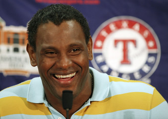 Rangers outfielder Sammy Sosa smiles during a news conference at the team's spring training baseball camp in Surprise