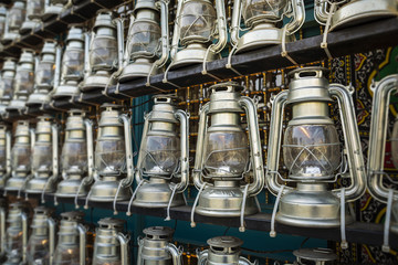 TEHRAN, IRAN - October 12, 2016: kerosene lamps in front of a mosque, as a symbol of religious mourning of Imam Husayn martyrdom in the Battle of Karbala.