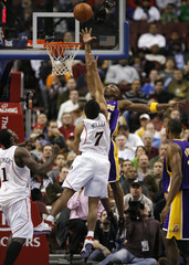 Los Angeles Lakers guard Kobe Bryant tries to block a shot by the Philadelphia 76ers guard Andre Miller in Philadelphia