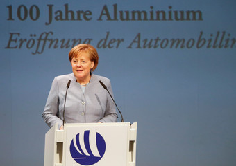 German Chancellor Angela Merkel speaks during the opening of a production line for the car industry at a branch of Norway's Hydro aluminum company in Grevenbroich