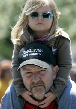Chrysler Sterling Assembly Plant pipe fitter Brian Bess wears his feelings about imported vehicles on his cap as his daughter sits on his shoulders during a auto workers rally at Dodge Park to protest the loss of manufacturing jobs in America in Sterling H