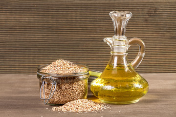Sesame seeds and oil On a wooden background