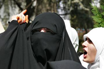 Veiled Jordanian women shout anti Israeli slogans during a sit-in in Amman