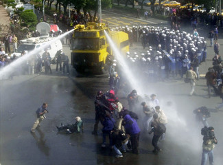 TAIWAN POLICE USE WATER CANNON ON PROTESTERS IN TAIPEI.