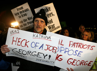 Demonstrator rallies during the State of the Union Address outside the US Capitol