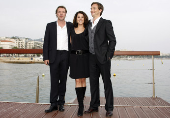 Cast members, Sebastian Koch of Germany, Neve Campbell of Canada and British actor Stephen Campbell Moore pose during a photo-call in Cannes