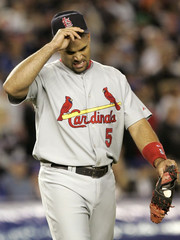 Cardinals' Albert Pujols walks to first base after a double play to get out against the New York Mets in the fourth inning during Game 1 of their NLCS playoff baseball game in New York