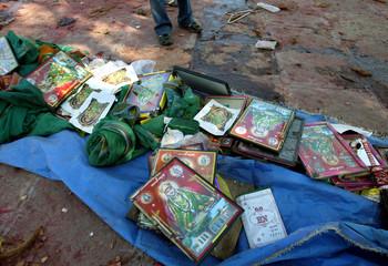 Damaged photo frames of Hindu gods and goddesses lie outside Mandherdevi temple in Wai village, India.