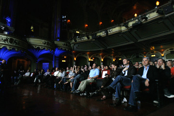 Guests watch a presentation by Electronic Arts during a media event before the opening day of E3 at the Orpheum theatre in Los Angeles